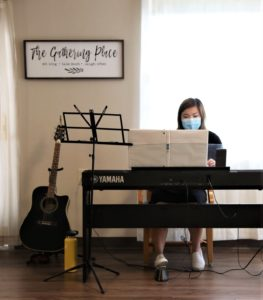 Negata sings and plays piano