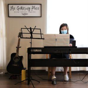 Yuka Nagata plays the piano at a nursing home