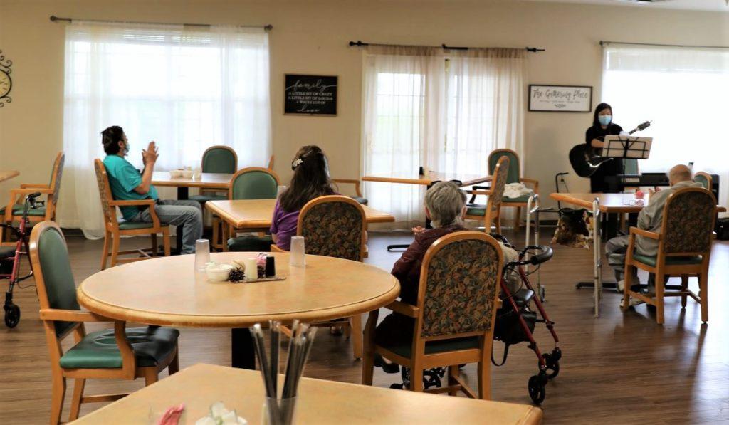 Residents listen to Negata's musical performance