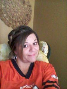 Danielle Soliz takes a selfie in a Broncos jersey